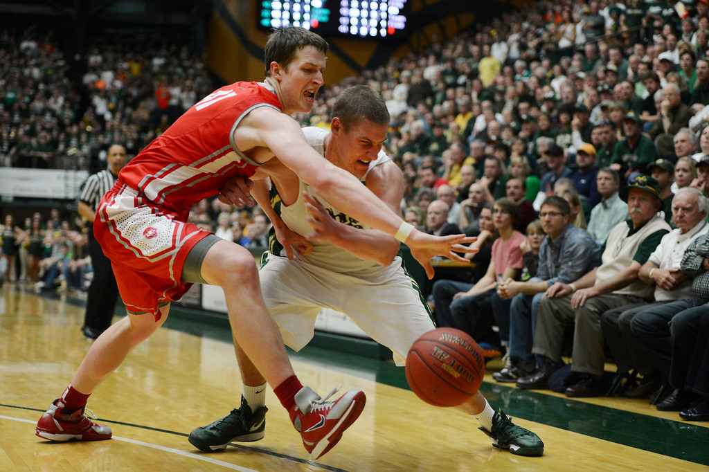 . Fort COLLINS, CO. - FEBRUARY 23: CSU Colton Iverson  battles for a loose ball with New Mexico Cameron Bairstow during second half action at Moby Arena in Fort Collin, CO February  24, 2013. The Colorado State Rams mens basketball team lost to the New Mexico Lobos, 82-91. (Photo By Craig F. Walker/The Denver Post)