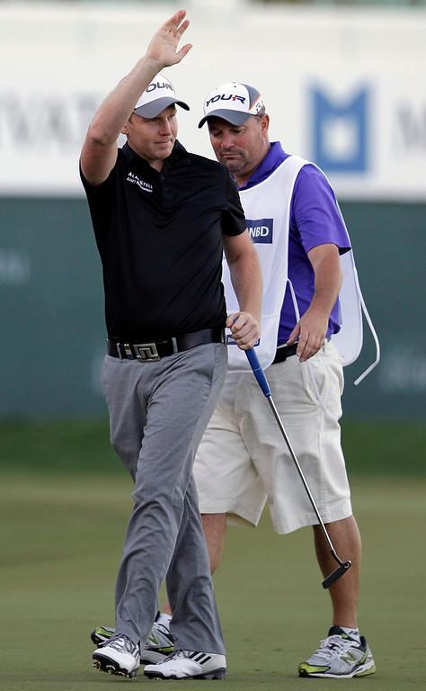 . Stephen Gallacher of Scotland waves after he wins the final round of the Dubai Desert Classic Golf tournament in Dubai, United Arab Emirates, Sunday, Feb. 3, 2013. (AP Photo/Kamran Jebreili)