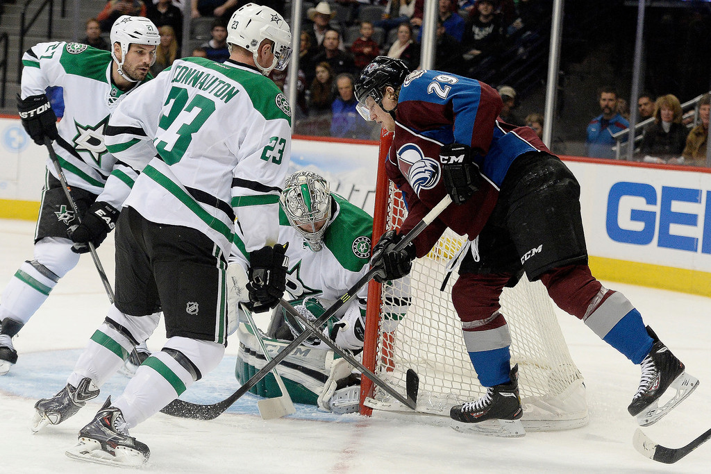 . Colorado Avalanche center Nathan MacKinnon (29) attempts a shot on Dallas Stars goalie Kari Lehtonen (32) as defenseman Kevin Connauton (23) and Aaron Rome (27) defend during the first period. (Photo by AAron Ontiveroz/The Denver Post)