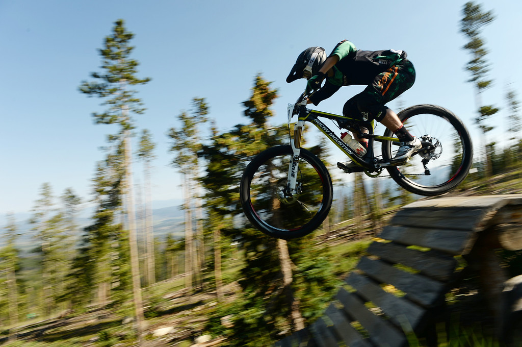 . WINTER PARK, CO. - July 26: Jesse Melamed controls the bike during the first stage of First international Enduro World Cup Championship ever in U.S. at Winter Park, Colorado. July 26, 2013. (Photo By Hyoung Chang/The Denver Post)