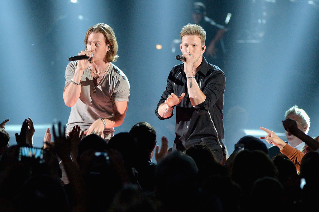 . NASHVILLE, TN - NOVEMBER 06:  Tyler Hubbard and Brian Kelly of Florida Georgia Line perform onstage during the 47th annual CMA Awards at the Bridgestone Arena on November 6, 2013 in Nashville, Tennessee.  (Photo by Rick Diamond/Getty Images)