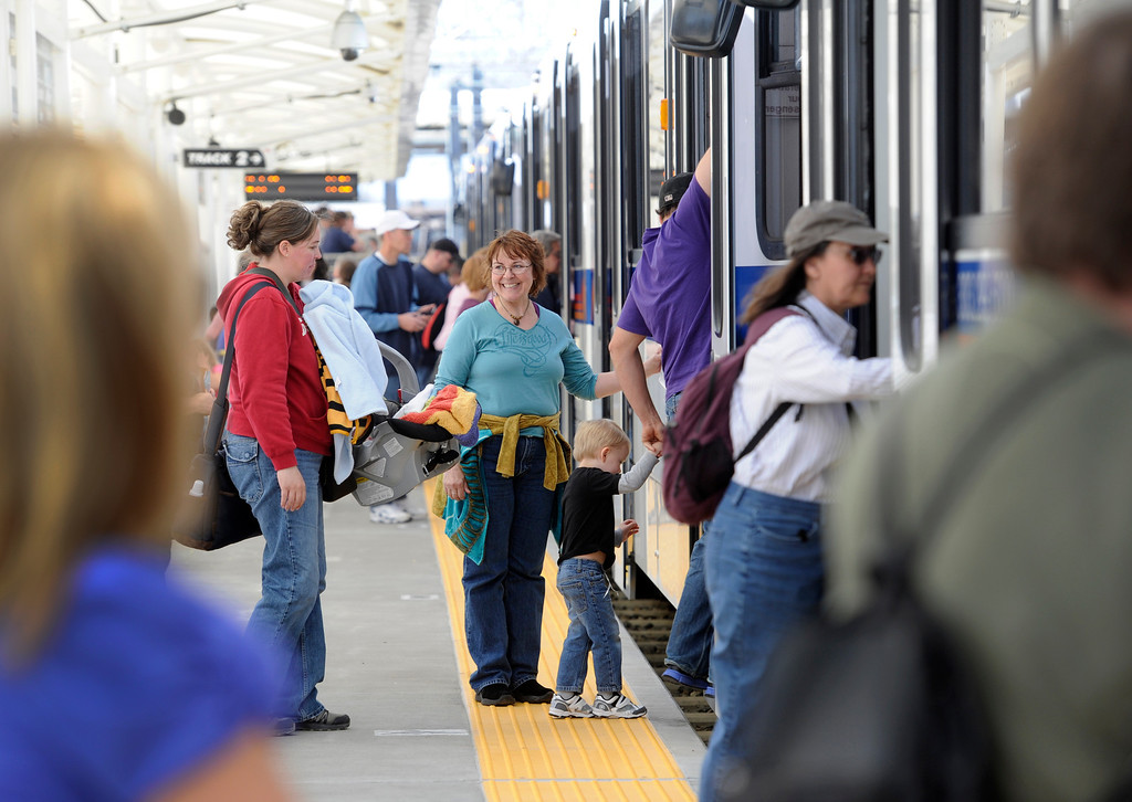 . DENVER, CO.- APRIL 27: Passengers board the train as RTD celebrates the opening of the West line of the light rail with free rides for all and a party atmosphere at many of the stops along the route. Union station had Denver sports teams mascots making the rounds as well as live music and food. (Photo By Kathryn Scott Osler/The Denver Post)