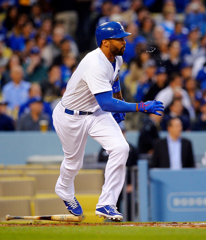 . Los Angeles Dodgers\' Matt Kemp spits as he hits an RBI single during the first inning of their baseball game against the Colorado Rockies, Tuesday, April 30, 2013, in Los Angeles. (AP Photo/Mark J. Terrill)
