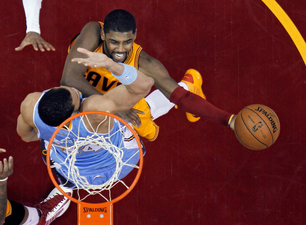 . Cleveland Cavaliers\' Kyrie Irving shoots over Denver Nuggets\' JaVale McGee in the first quarter of an NBA basketball game Saturday, Feb. 9, 2013, in Cleveland. (AP Photo/Mark Duncan)