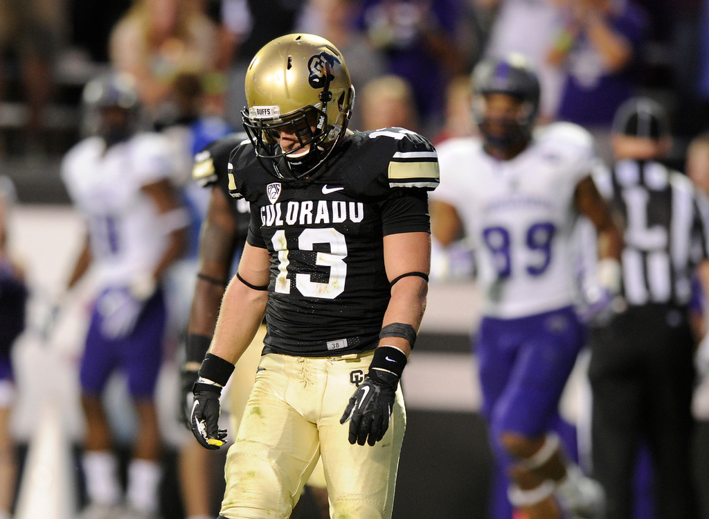 . BOULDER, CO. - SEPTEMBER 76: Buffs defensive back Parker Orms (13) hung his head after he got beat on the Bear\'s touchdown pass late in the second quarter. The University of Colorado football team hosted Central Arkansas at Folsom Field Saturday night, September 7, 2013. Photo By Karl Gehring/The Denver Post