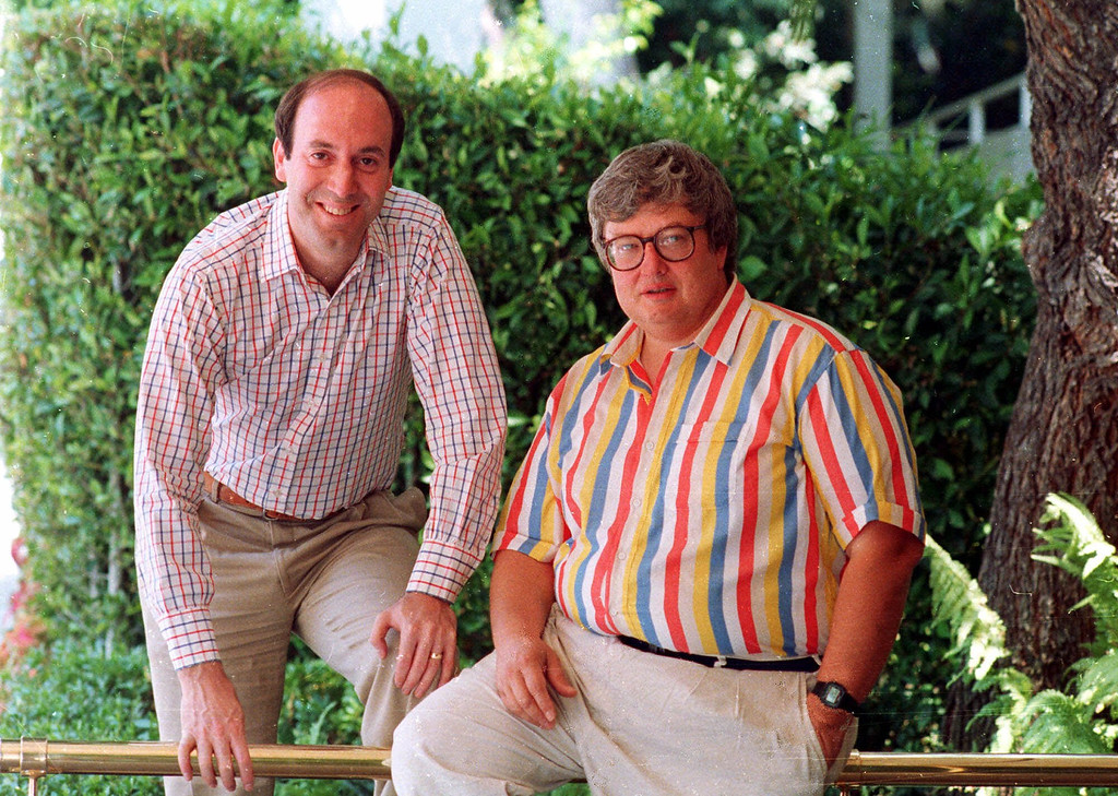 ". Roger Ebert, right, poses with Gene Siskel in Los Angeles in this 1986 photo.  The rivalry between the two Chicago film critics who combine their talents on the movie review show ""Siskel & Ebert & The Movies\"" has helped make them media stars.  (AP Photo/DOUGLAS C. PIZAC)"