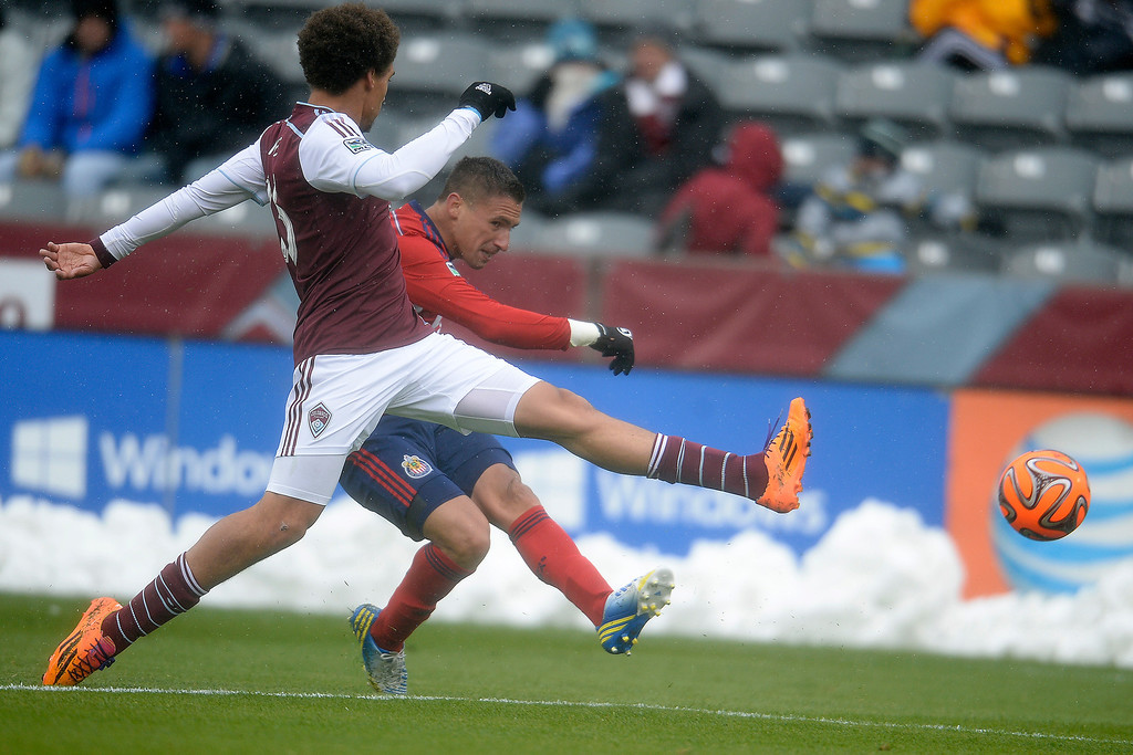 . Leandro Barrera (11) of Chivas USA kicks the ball past Chris Klute (15) of Colorado Rapids during the second half. Chivas USA defeated the Colorado Rapids 3-1 on Sunday, May 11, 2014. (Photo by AAron Ontiveroz/The Denver Post)