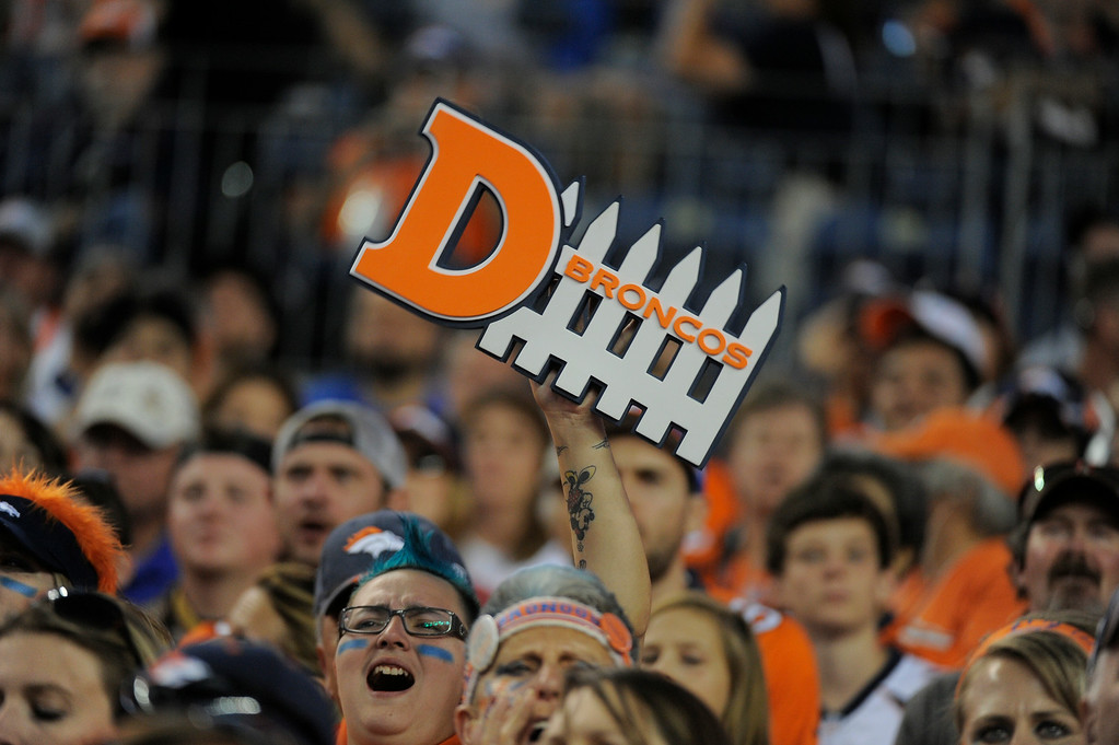. DENVER, CO - AUGUST 23: Denver Broncos fans yell out during the second quarter against the Houston Texans August 23, 2014 at Sports Authority Field at Mile High Stadium. (Photo by John Leyba/The Denver Post)