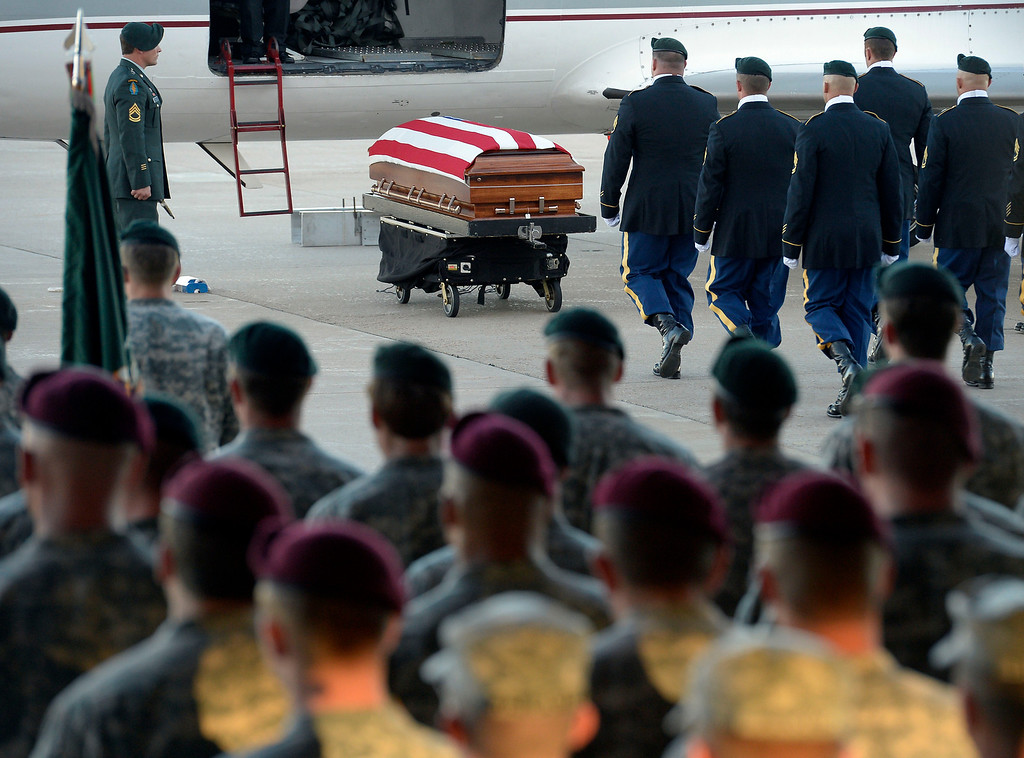. Color Guard make their way to retrieve the casket of staff sergeant Liam Nevins, 32, September 30, 2013 and load on the hearse. Nevins, of Denver, was killed two weekends ago in Afghanistan. (Photo by John Leyba/The Denver Post)
