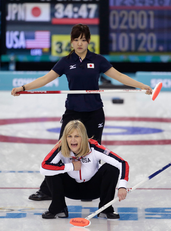 . Erika Brown, skip of the United States team, lower, shouts instructions to her sweepers during women\'s curling competition against Japan at the 2014 Winter Olympics, Thursday, Feb. 13, 2014, in Sochi, Russia. (AP Photo/Robert F. Bukaty)