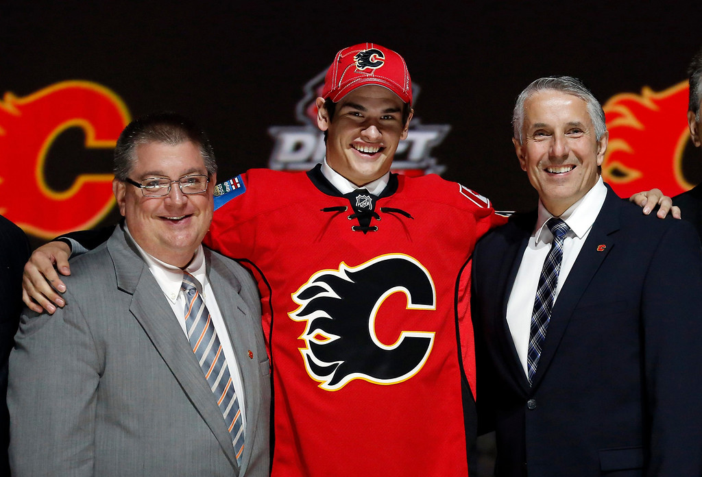 . Sean Monahan poses with Calgary Flames executives after being selected by the flames as the sixth overall pick in the 2013 National Hockey league (NHL) draft in Newark, New Jersey, June 30, 2013. REUTERS/Brendan McDermid