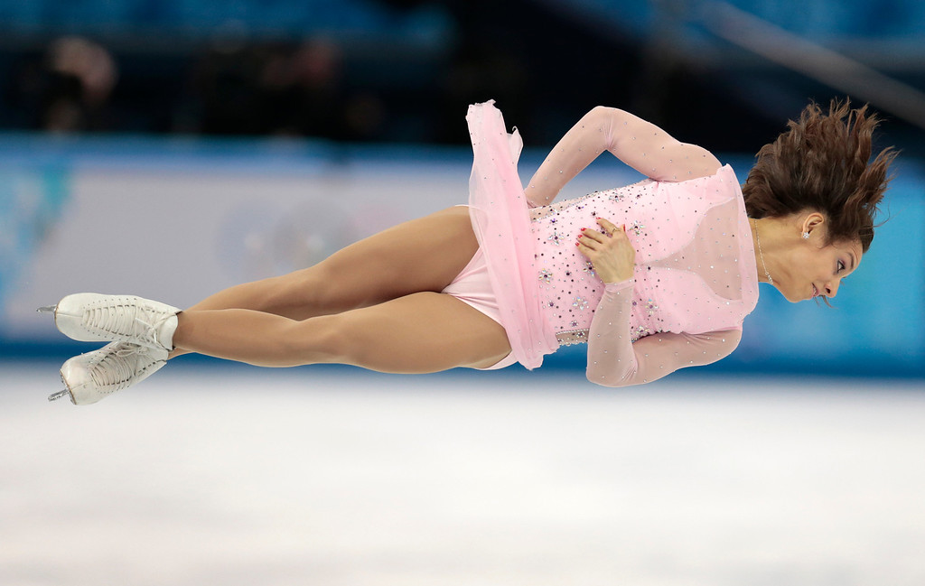 Description of . Meagan Duhamel and Eric Radford of Canada compete in the pairs short program figure skating competition at the Iceberg Skating Palace during the 2014 Winter Olympics, Tuesday, Feb. 11, 2014, in Sochi, Russia. (AP Photo/Ivan Sekretarev)