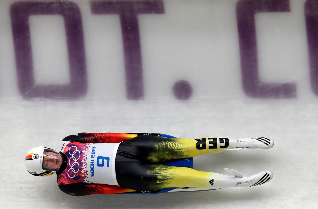 . Tatjana Huefner of Germany speeds down the track in her first run during the women\'s singles luge competition at the 2014 Winter Olympics, Monday, Feb. 10, 2014, in Krasnaya Polyana, Russia. (AP Photo/Michael Sohn)