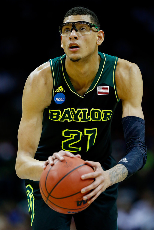 . Isaiah Austin #21 of the Baylor Bears takes a foul shot against the Creighton Bluejays during the third round of the 2014 NCAA Men\'s Basketball Tournament at the AT&T Center on March 23, 2014 in San Antonio, Texas.  (Photo by Tom Pennington/Getty Images)