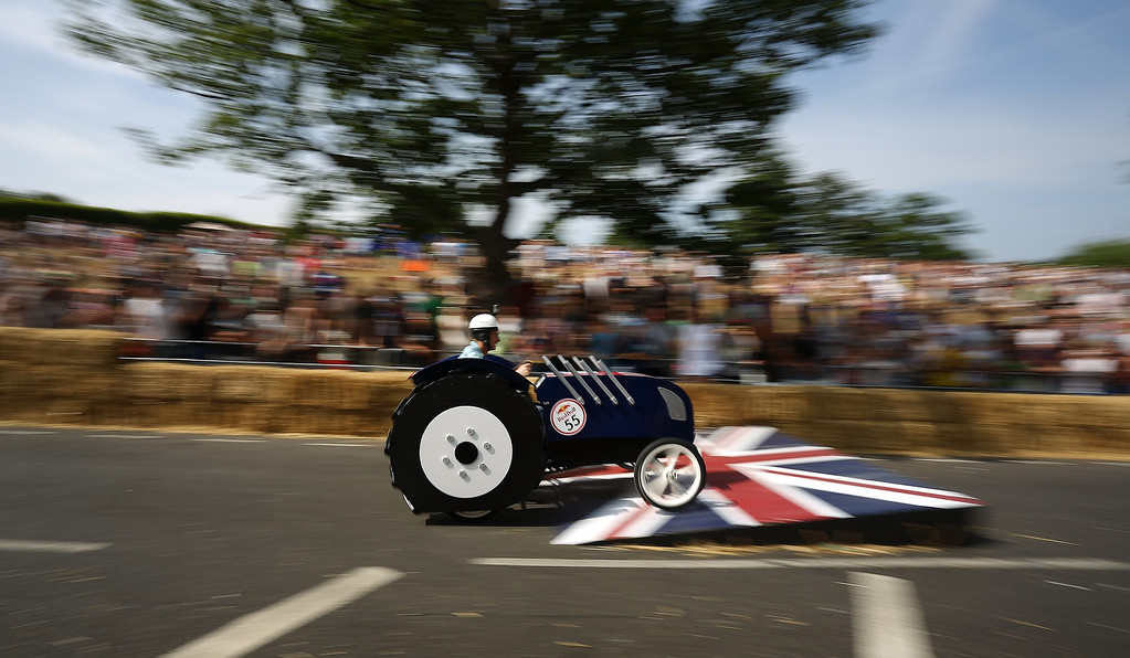 . A team go over a jump during the Red Bull Soapbox Race at Alexandra Palace on July 14, 2013 in London, England. The Red Bull Soapbox Race returned to London after nine years and encourages competitors to build and race their own homemade soapboxes down a hill.  (Photo by Jordan Mansfield/Getty Images)