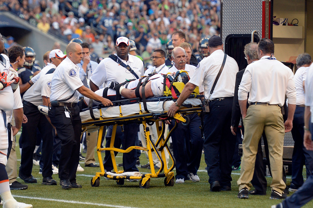 . SEATTLE, WA. - AUGUST 17: Denver Broncos defensive end Derek Wolfe (95) gets looked at by the medical staff after suffering an injury in the first quarter against the Seattle Seahawks August 17, 2013 at Century Link Field. Wolfe was put on an ambulance and taken to the hospital. (Photo By John Leyba/The Denver Post)