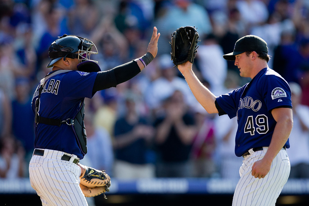 . Catcher Yorvit Torrealba #8 and Rex Brothers #49 of the Colorado Rockies celebrate after defeating the Chicago Cubs 4-3 at Coors Field on July 21, 2013 in Denver, Colorado.  (Photo by Justin Edmonds/Getty Images)