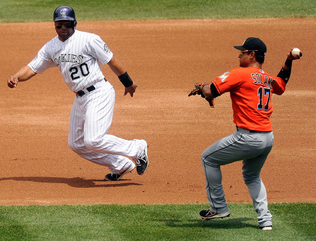 . Miami infielder Donovan Solano forced out Rockies baserunner Wilin Rosario on a fielders choice in the second inning. The Colorado Rockies hosted the Miami Marlins at Coors Field Thursday afternoon, July 25, 2013. Photo By Karl Gehring/The Denver Post