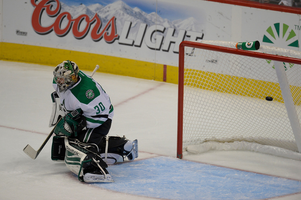 . DENVER, CO - OCTOBER 15: Dallas Stars goalie Dan Ellis (30) can\'t make a save on a shot by Colorado Avalanche center Matt Duchene (9) as the puck sails by him during the second period October 15, 2013 at Pepsi Center.(Photo By John Leyba/The Denver Post)