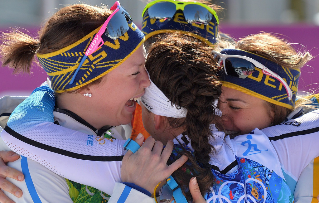 . Sweden\'s team celebrate after winning the Women\'s  4x5 km Relay competition at the Sochi 2014 Olympic Games, Krasnaya Polyana, Russia, 15 February 2014.  EPA/HENDRIK SCHMIDT