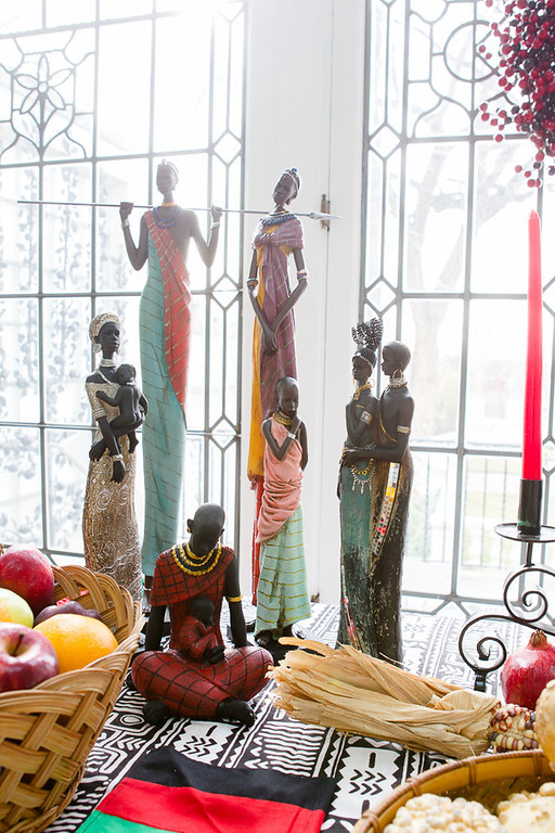 . Kwanzaa figurines, a contribution of the Kwanzaa Committee of Denver, grace a table at the Governor\'s mansion as part of its holiday displays. Photo by Mark Broste