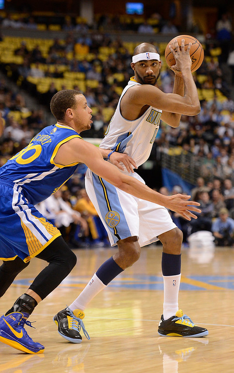 . Golden State Warriors point guard Stephen Curry (30) defends Denver Nuggets small forward Corey Brewer (13) in the first quarter. The Denver Nuggets took on the Golden State Warriors in Game 5 of the Western Conference First Round Series at the Pepsi Center in Denver, Colo. on April 30, 2013. (Photo by John Leyba/The Denver Post)