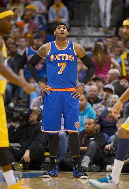 . Carmelo Anthony (7) of the New York Knicks looks on during a break in the action against the Denver Nuggets in the first quarter March 13,  2013 at Pepsi Center. (Photo By John Leyba/The Denver Post)
