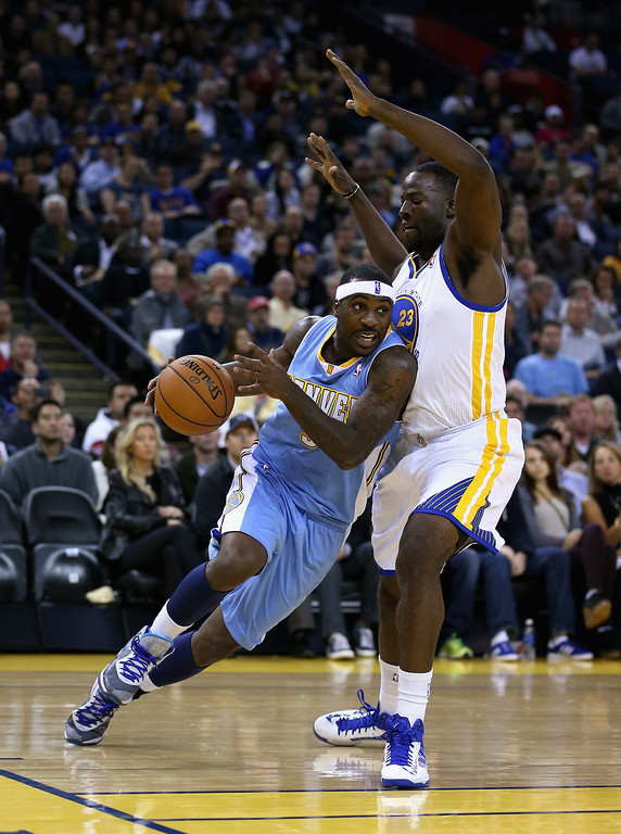 . OAKLAND, CA - NOVEMBER 29: Ty Lawson #3 of the Denver Nuggets drives on Draymond Green #23 of the Golden State Warriors at Oracle Arena on November 29, 2012 in Oakland, California.  (Photo by Ezra Shaw/Getty Images)