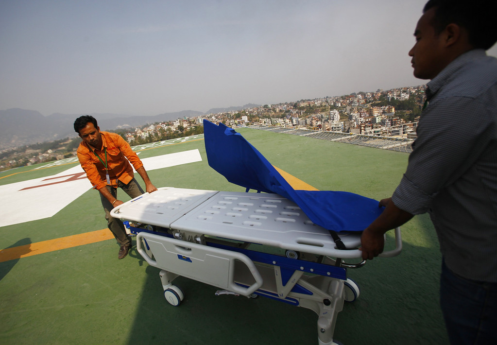 . Hospital staff get ready to receive the injured from an avalanche, on helipad of Grandy hospital, in Katmandu, Nepal, Friday, April 18, 2014. An avalanche swept down a climbing route on Mount Everest early Friday, killing at least 12 Nepalese guides and leaving three missing in the deadliest disaster on the world\'s highest peak. (AP Photo/Niranjan Shrestha)