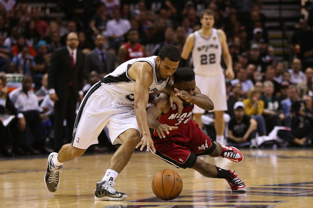 . Cory Joseph #5 of the San Antonio Spurs and Norris Cole #30 of the Miami Heat go after a loose ball in the second half during Game Three of the 2013 NBA Finals at the AT&T Center on June 11, 2013 in San Antonio, Texas.   (Photo by Mike Ehrmann/Getty Images)