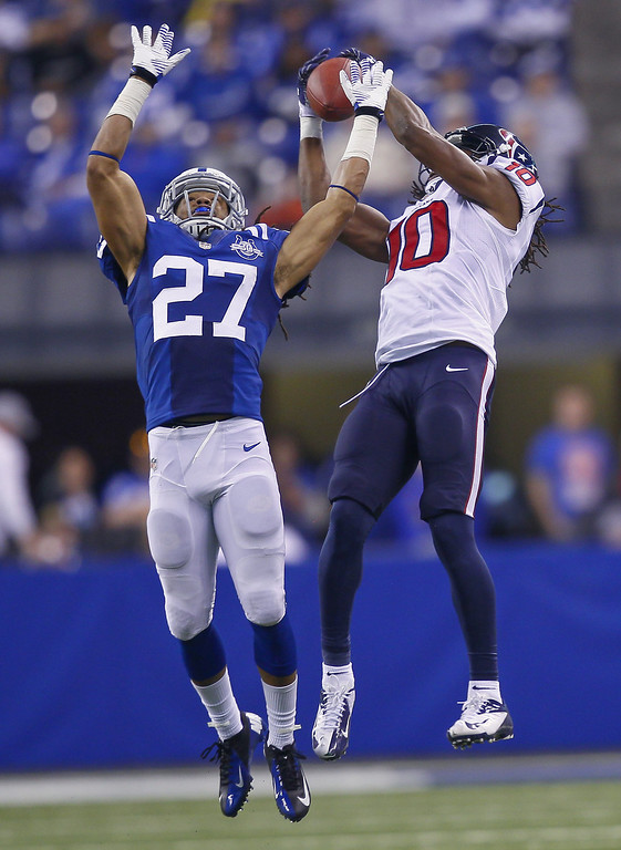 . Josh Gordy #27 of the Indianapolis Colts and DeAndre Hopkins #10 of the Houston Texans go up for a pass at Lucas Oil Stadium on December 15, 2013 in Indianapolis, Indiana. Indianapolis defeated Houston 25-3. (Photo by Michael Hickey/Getty Images)