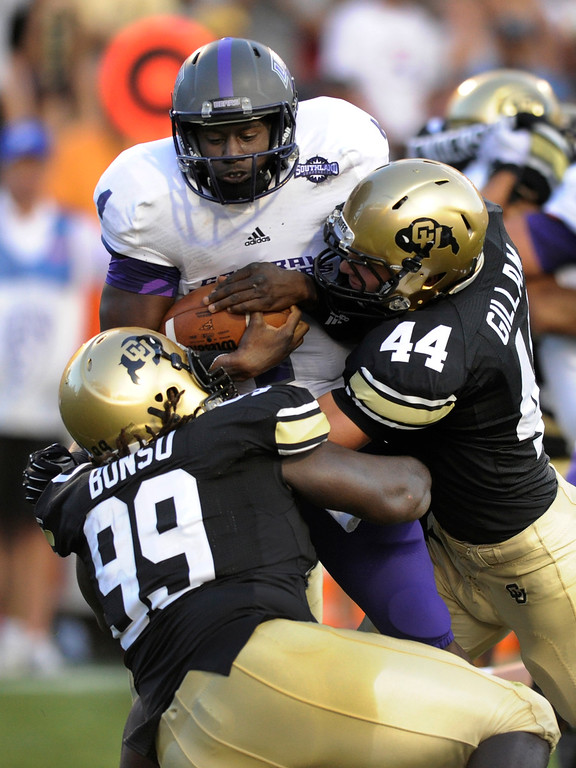 . BOULDER, CO. - SEPTEMBER 76: Buffs defenders Nate Bonsu (99) and Addison Gillam (44) brought down ACU quarterback Wynnick Smothers (4) in the first half. The University of Colorado football team hosted Central Arkansas at Folsom Field Saturday night, September 7, 2013. Photo By Karl Gehring/The Denver Post