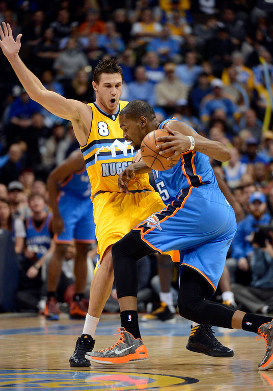 . DENVER, CO. - JANUARY 20: Oklahoma City Thunder small forward Kevin Durant (35) runs in to Denver Nuggets small forward Danilo Gallinari (8) during the first quarter January 20,  2013 at Pepsi Center. (Photo By John Leyba / The Denver Post)