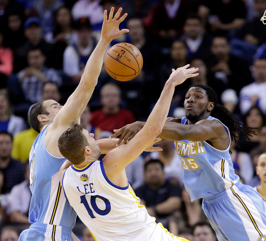 . Denver Nuggets\' Kenneth Faried (35) blocks a shot attempt from Golden State Warriors\' David Lee (10) during the first half of an NBA basketball game in Oakland, Calif., Thursday, Nov. 29, 2012. (AP Photo/Marcio Jose Sanchez)