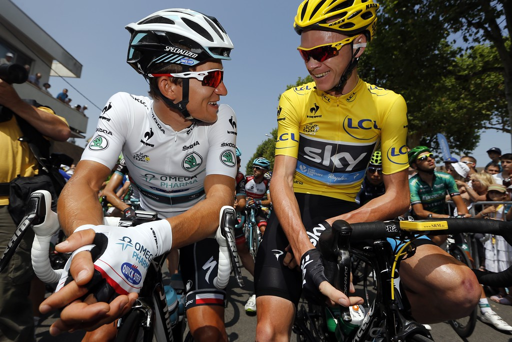 . Overall leader\'s yellow jersey Britain\'s Christopher Froome (R) speaks with best young\'s white jersey Poland\'s Michal Kwiatkowski, in Saint-Pourçain-sur-Sioule at the village departure, as they wait for the start of the 191 km fourteenth stage of the 100th edition of the Tour de France cycling race on July 13, 2013 between Saint-Pourcain-sur-Sioule and Lyon, central eastern France. PASCAL GUYOT/AFP/Getty Images