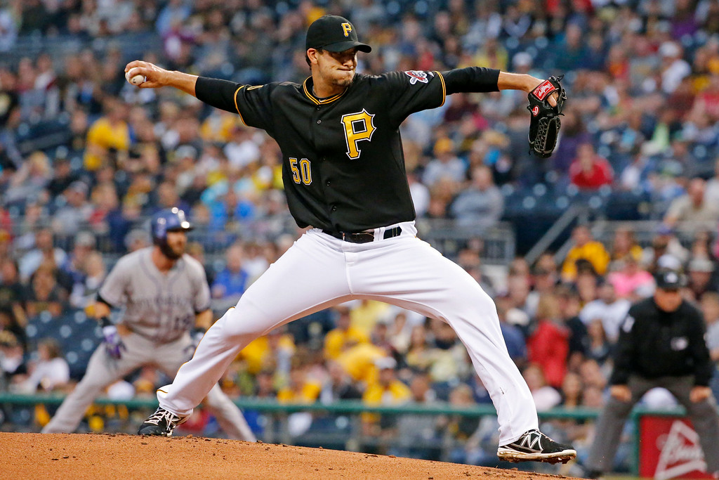 . Pittsburgh Pirates starting pitcher Charlie Morton delivers during the first inning of a baseball game against the Colorado Rockies in Pittsburgh Saturday, July 19, 2014. (AP Photo/Gene J. Puskar)