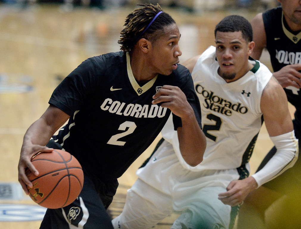 . Colorado\'s Xavier Johnson drives to the hoop past Daniel Bejarano during an NCAA game against CSU on Tuesday, Dec. 3, 2013, at the Moby Arena in Fort Collins. CU won the game 67-62.