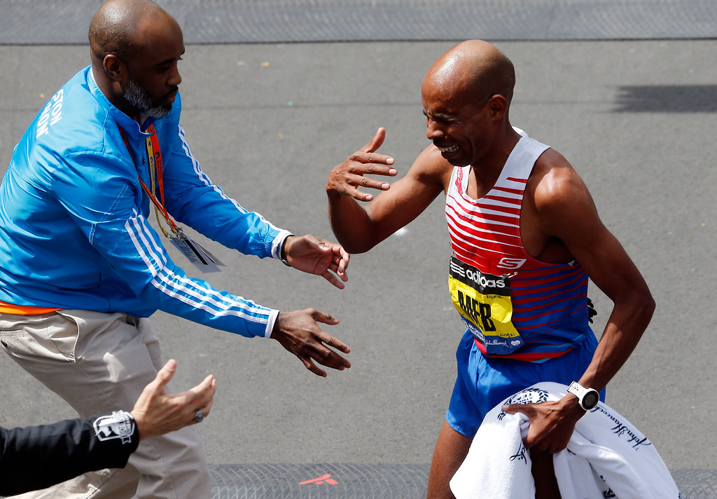 . Meb Keflezighi of the United States reacts after winning the 118th Boston Marathon on April 21, 2014 in Boston, Massachusetts.  (Photo by Jim Rogash/Getty Images)