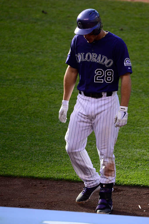 . Nolan Arenado (28) of the Colorado Rockies reacts to grounding out in the eight inning against the Los Angeles Dodgers during the Dodgers\' 10-8 win in Denver on Monday, September 2, 2013. The Colorado Rockies hosted the Los Angeles Dodgers at Coors Field. (Photo by AAron Ontiveroz/The Denver Post)