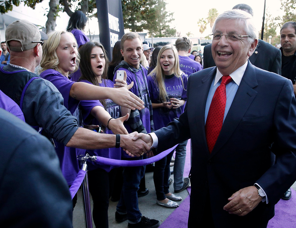 . NBA Commissioner David Stern, right, in greeted by Sacramento Kings fans as he arrives at Sleep Train Arena to attend the Kings\' NBA basketball season opener against the Denver Nuggets in Sacramento, Calif., Wednesday, Oct. 30, 2013. (AP Photo/Rich Pedroncelli)