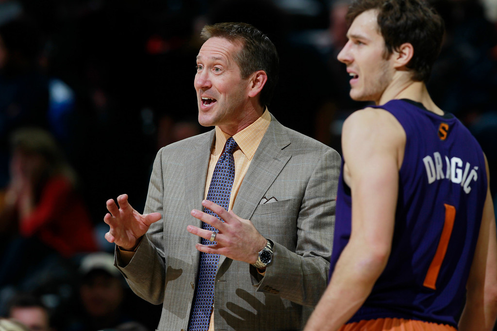 . Phoenix Suns head coach Jeff Hornacek, left, jokes with guard Goran Dragic, of Slovenia, during a time out against the Denver Nuggets with four seconds remaining in the fourth quarter of the Suns\' 103-99 victory in an NBA basketball game in Denver on Friday, Dec. 20, 2013. (AP Photo/David Zalubowski)