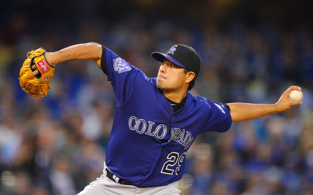 . Colorado Rockies starting pitcher Jorge De La Rosa throws to the plate during the first inning of their baseball game against the Los Angeles Dodgers, Tuesday, April 30, 2013, in Los Angeles. (AP Photo/Mark J. Terrill)