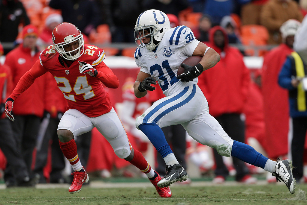 . Indianapolis Colts running back Donald Brown (31) races for a touchdown past Kansas City Chiefs cornerback Brandon Flowers (24) during the second half of an NFL football game at Arrowhead Stadium in Kansas City, Mo., Sunday, Dec. 22, 2013. (AP Photo/Charlie Riedel)