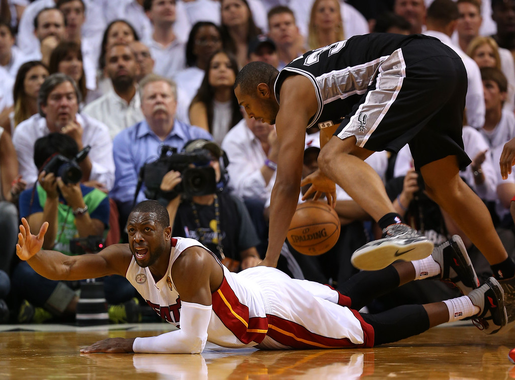 . Dwyane Wade #3 of the Miami Heat reacts after going after a loose ball against Boris Diaw #33 of the San Antonio Spurs in the second half during Game Six of the 2013 NBA Finals at AmericanAirlines Arena on June 18, 2013 in Miami, Florida.  (Photo by Mike Ehrmann/Getty Images)