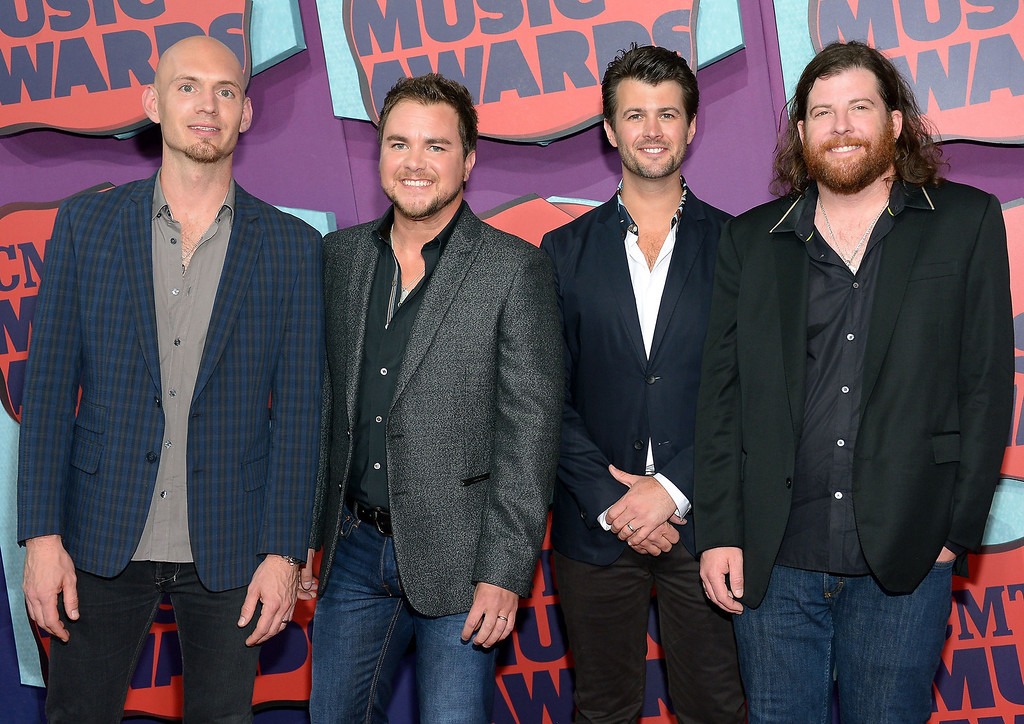 . Jon Jones, Mike Eli, Chris Thompson and James Young of the Eli Young Band attend the 2014 CMT Music awards at the Bridgestone Arena on June 4, 2014 in Nashville, Tennessee.  (Photo by Michael Loccisano/Getty Images)