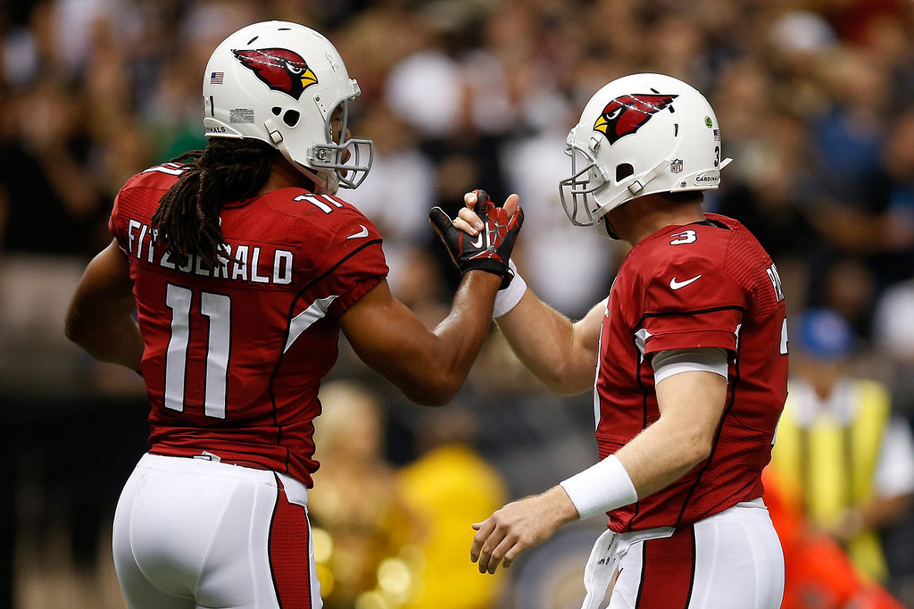 . NEW ORLEANS, LA - SEPTEMBER 22:   Carson Palmer and  Larry Fitzgerald #11 of the Arizona Cardinals celebrate after a touchdown against the New Orleans Saints at the Mercedes-Benz Superdome on September 22, 2013 in New Orleans, Louisiana.  (Photo by Chris Graythen/Getty Images)