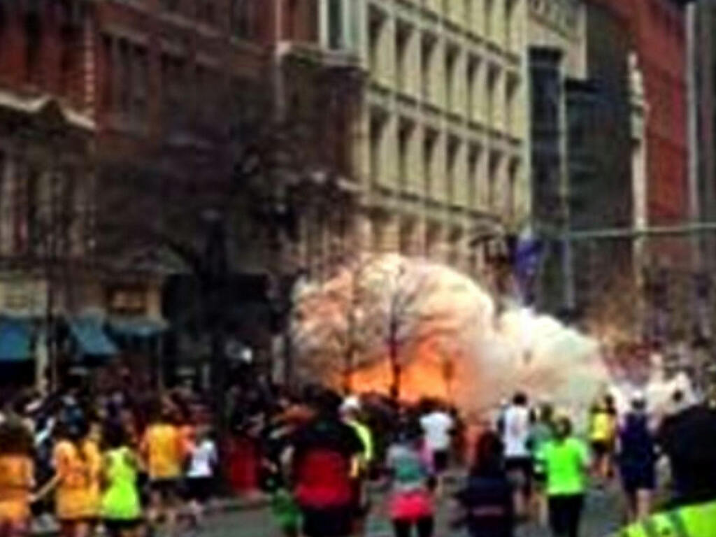 . In this image from video provided by WBZ TV, a bomb explodes near the finish line of the Boston Marathon in Boston on Monday, April 15, 2013. (AP Photo/WBZTV)