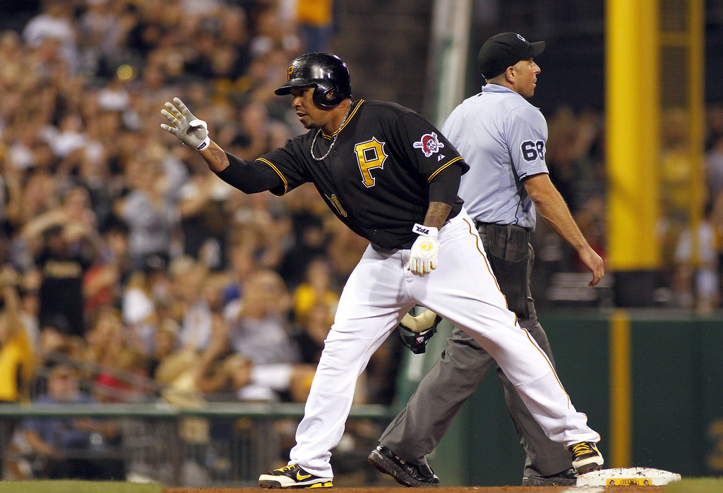 . PITTSBURGH, PA - AUGUST 03:  Jose Tabata #31 of the Pittsburgh Pirates celebrates after hitting a triple in the sixth inning against the Colorado Rockies during the game on August 3, 2013 at PNC Park in Pittsburgh, Pennsylvania.  (Photo by Justin K. Aller/Getty Images)