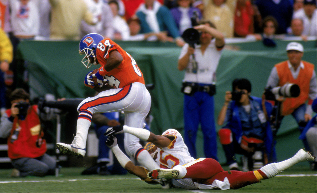 . Wide receiver Ricky Nattiel #84 of the Denver Broncos break away from a tackle by cornerback Barry Wilburn #45 of the Washington Redskins in route to the end zone during Super Bowl XXII at the Jack Murphy Stadium on January 31, 1988 in San Diego, California.  The Redskins won 42-10.  (Photo by George Rose/Getty Images)