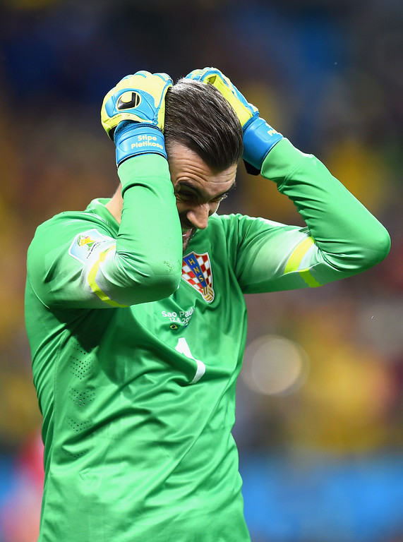 . Stipe Pletikosa of Croatia reacts after allowing a goal on a penalty kick by Neymar of Brazil (not pictured) during the 2014 FIFA World Cup Brazil Group A match between Brazil and Croatia at Arena de Sao Paulo on June 12, 2014 in Sao Paulo, Brazil.  (Photo by Buda Mendes/Getty Images)